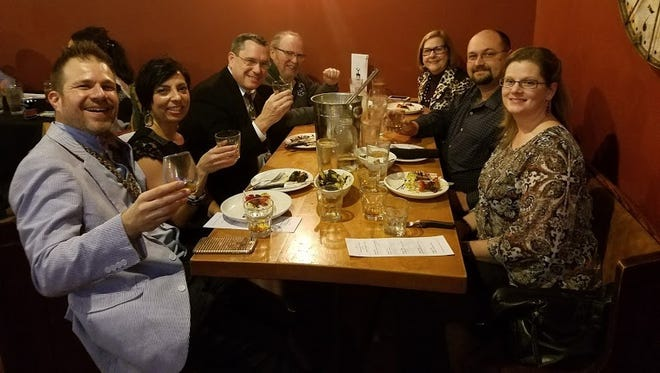 Whisky sommelier Tom Fischer, left, joins a table of enthusiastic diners at a previous whisky pairing dinner at Commonwealth Kitchen and Bar in Henderson.