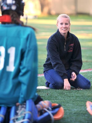 Wellesley High School field hockey coach Erin Stickle, pictured in 2012, saw her team beat Brookline on Monday.