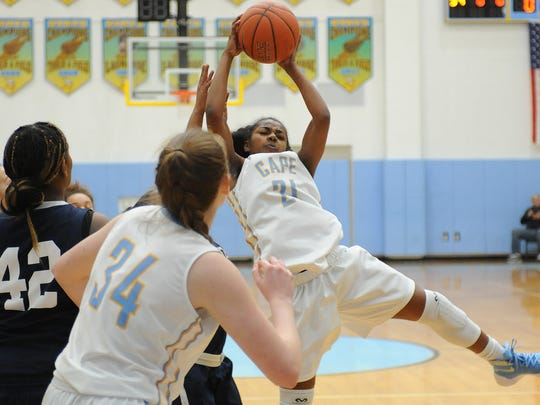 Capes Lexi Watkins grabs the ball as Cape Henlopen