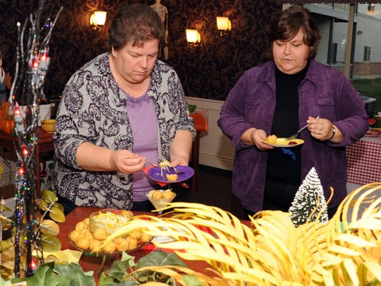 Ohio State University Extension Director Mary Longo, left, continues to recover from brain surgery in March to remove a tumor. A benefit spaghetti dinner is scheduled for 4:30 p.m. Saturday at River Valley High School. All proceeds will be given to the Longo family. Longo is shown with  Carolyn Hall at the Marion Star Holiday Cookbook Cookoff in 2011.