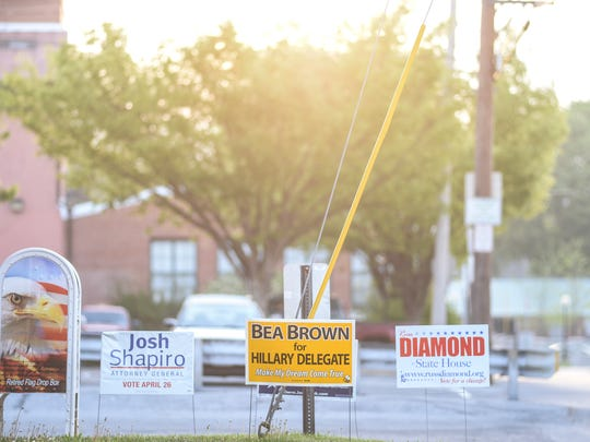 Signs are posted outside of the Annville Township building — Annville West polling location — as voters headed to the polls to vote in the Pennsylvania primary election on Tuesday, April 26, 2016.