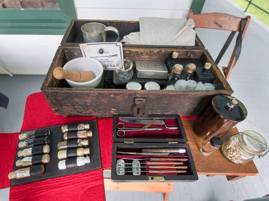 John Ream's collection of Civil War medicine while he takes on the part of John Weakly, who was a hospital steward (physicians assistant), during an encampment of the 87th Pennsylvania Volunteers, Company C at the opening day for the Ma & Pa Railroad Heritage Village at Muddy Creek Forks Sunday June 3, 2018.