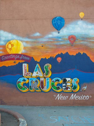 """Artists have created a """"Greetings from Las Cruces, New Mexico"""" mural on the north-facing wall of Insta-Copy, 318 N Main St. Seen here Wednesday Dec. 13, 2017, the mural was expected to be completed over the weekend. Residents and tourists are encouraged to take photos next to the mural and share on social media."""