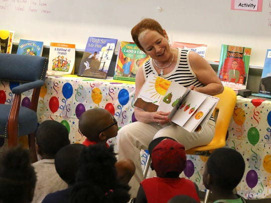 Marcy Driscoll, dean of the College of Education at Florida State, reads to student s at North Florida Freedom School camp at FAMUDRS.
