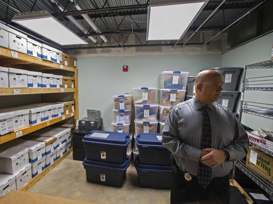 Colchester Police Detective Keith Schaffer gives a tour of the department's evidence room on Tuesday, November 3, 2015. The department has adopted sweeping new protocols in the wake of revelations in 2014 that now-former Det. Tyler Kinney had tampered with evidence in the room.  Evidence that Kinney had access to is now segregated in bins, right, from evidence gathered since he was fired.