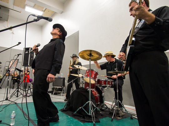 Johnny Cash, as portrayed by George Richard of Burlington, center, performs for inmates at the Marble Valley Regional Correctional Facility in Rutland on Wednesday, November 30, 2016. Playing with Richard are, from left, Donnie Ray Quenneville of South Burlington, Wayne Wanser of Milton and Shawn Emery of Colchester.