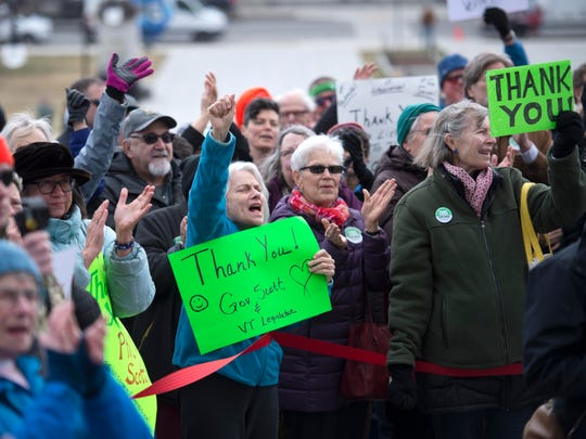 Supporters cheer as Gov. Phil Scott speaks before signing three gun reform bills on the steps of the Statehouse in Montpelier on Wednesday , April 11, 2018.