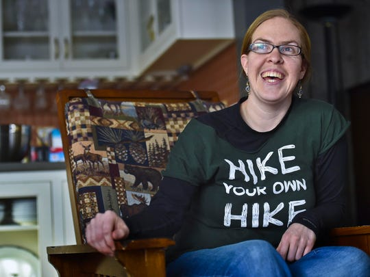 """You're excited to be done. You're glad it's over,"" Lucy Parker, pictured here in her Starksboro home, said of her lengthy hikes. ""But you don't know whether you should cry or you should laugh.''"