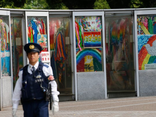 A police officer patrols at Hiroshima Peace Memorial