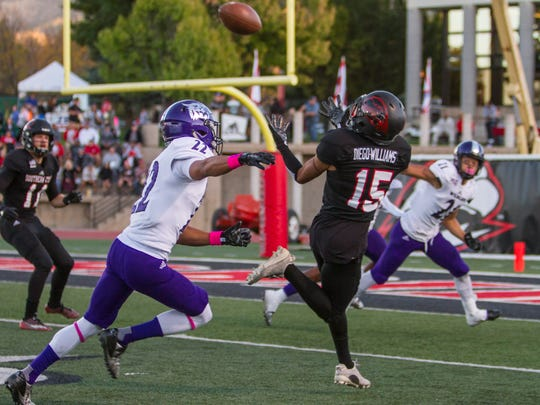 Southern Utah wide receiver Isaiah Diego-Williams (15) catches a pass for a touchdown during the first quarter of Saturday's game against Weber State in Cedar City, Oct. 22, 2016.