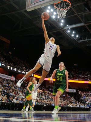 Connecticut Huskies forward Gabby Williams glides to the basket.