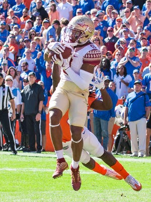 Florida State junior wide receiver Nyqwan Murray (8) picks off a throw from the Gators during the first quarter at Ben Griffin Stadium.
