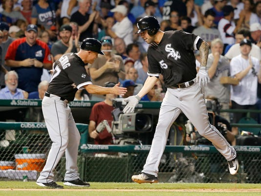 Chicago White Sox third base coach Joe McEwing greets Anthony Ranaudo at third after Ranaudo's home run off Chicago Cubs starting pitcher Jason Hammel during the fifth inning of a baseball game Wednesday, July 27, 2016, in Chicago. (AP Photo/Charles Rex Arbogast)