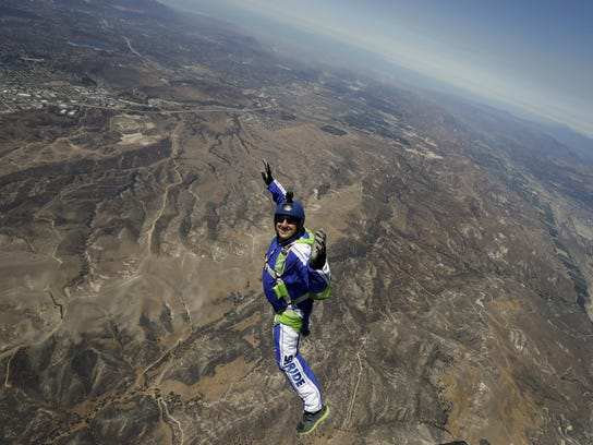 In this Monday, July 25, 2016 photo, skydiver Luke