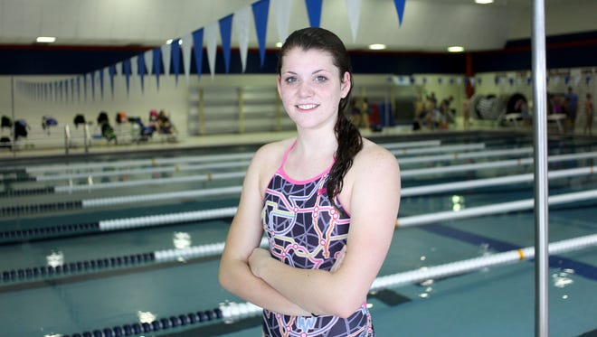 City High standout swimmer Alayna McCafferty stops for a photo after practice at Mercer Aquatic Center on Monday, September 16, 2013.