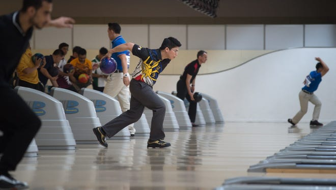 Frederick Ong of the Philippines bowls during the men's single's squad A event of the 2014 Incheon Asian Games, at the bowling venue in Anyang, near Incheon on September 23, 2014. AFP PHOTO / Ed Jones        (Photo credit should read ED JONES/AFP/Getty Images)
