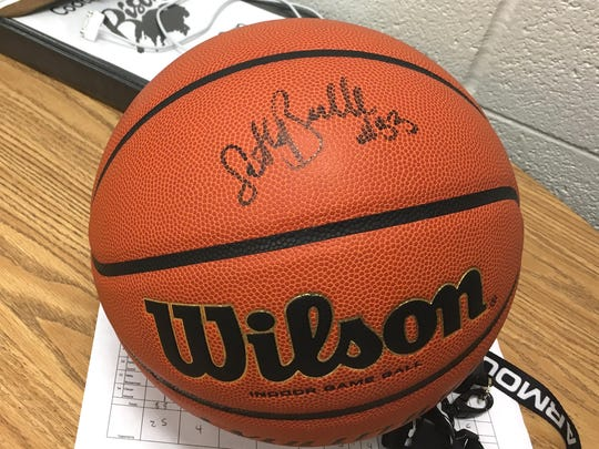 Samantha Brunelle signed a basketball for Buffalo Gap Friday night, Jan. 5. She was there to watch her next opponent, Wilson Memorial, play the Bison.