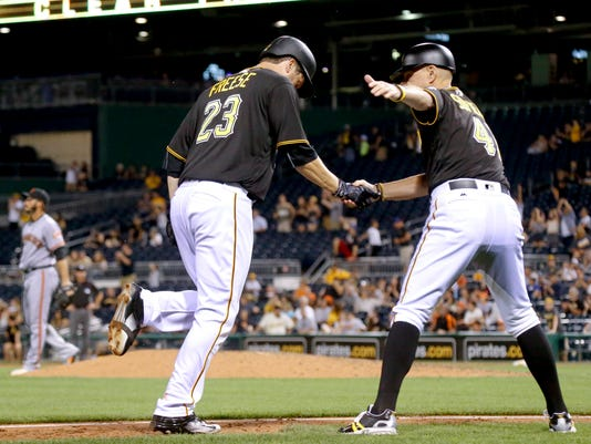 Pittsburgh Pirates' David Freese (23) is greeted by third base coach Rick Sofield after hitting a two-run home run off San Francisco Giants relief pitcher George Kontos, left, during the eighth inning of a baseball game, Tuesday, June 21, 2016, in Pittsburgh. The Giants won 15-4. (AP Photo/Keith Srakocic)