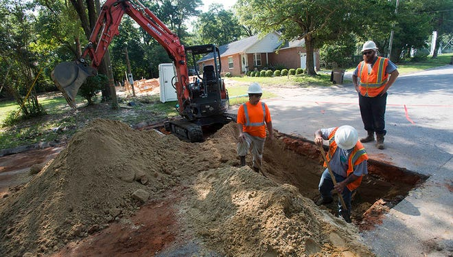 """ECUA crews work to connect a new sewer main near the intersection of """"I"""" and Brainerd Street in downtown Pensacola. (News Journal file photo)"""