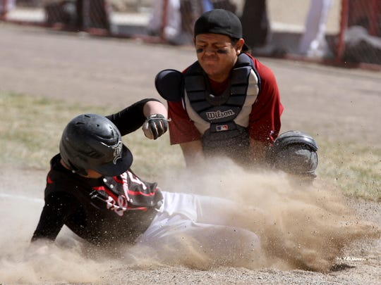 Shiprock's Zander Dale tags out Dolores, Colo.'s Josh McCoy during a March 21 game at Shiprock High School.