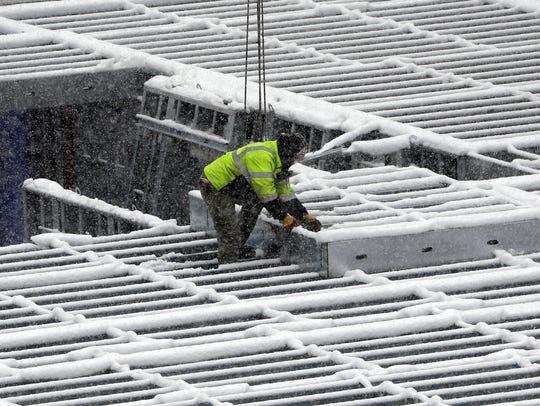 Construction crews keep the progress going despite