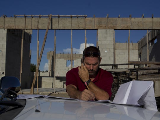 Paul Homes Project Manager Rich Verblaauw (cq) works on a Burnt Store Lakes home project Thursday, September 5 in Punta Gorda.