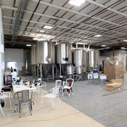 Work continues inside Big Grove Brewery on Gilbert