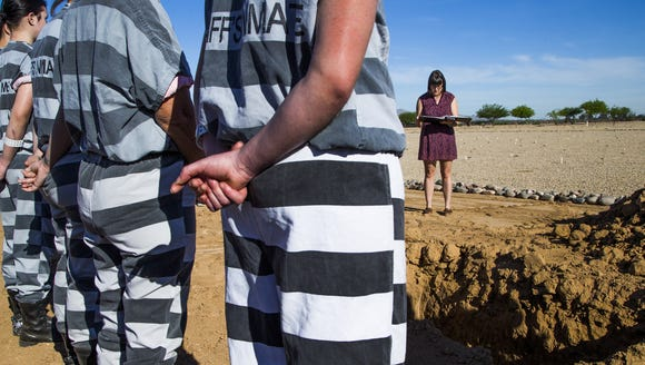 A Maricopa County women's chain gang and volunteer