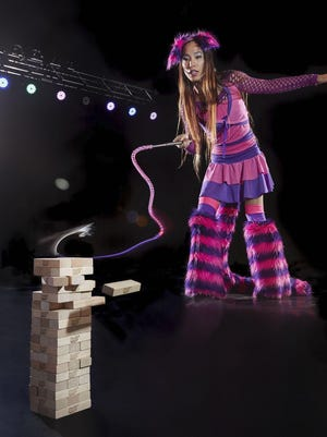 April Choi, who holds the record for the most Jenga blocks removed by whip in one minute, appears in the Guinness Book of World Records in 2018.