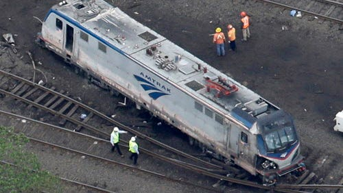 Emergency personnel work at the scene of a deadly train wreck in Philadelphia on May 13, 2015.