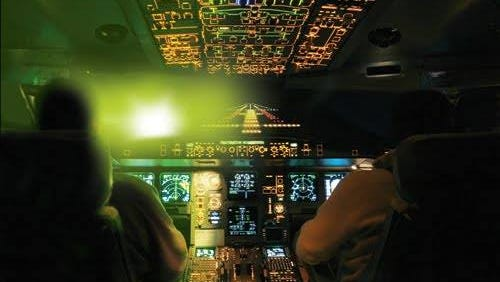 More than 20 aircraft, including one in Covington, were hit by lasers from the ground Wednesday night, according to the Federal Aviation Administration.