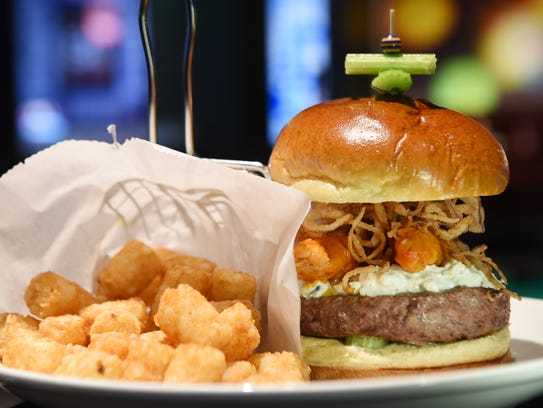 The buffalo burger with a side of tater tots is among