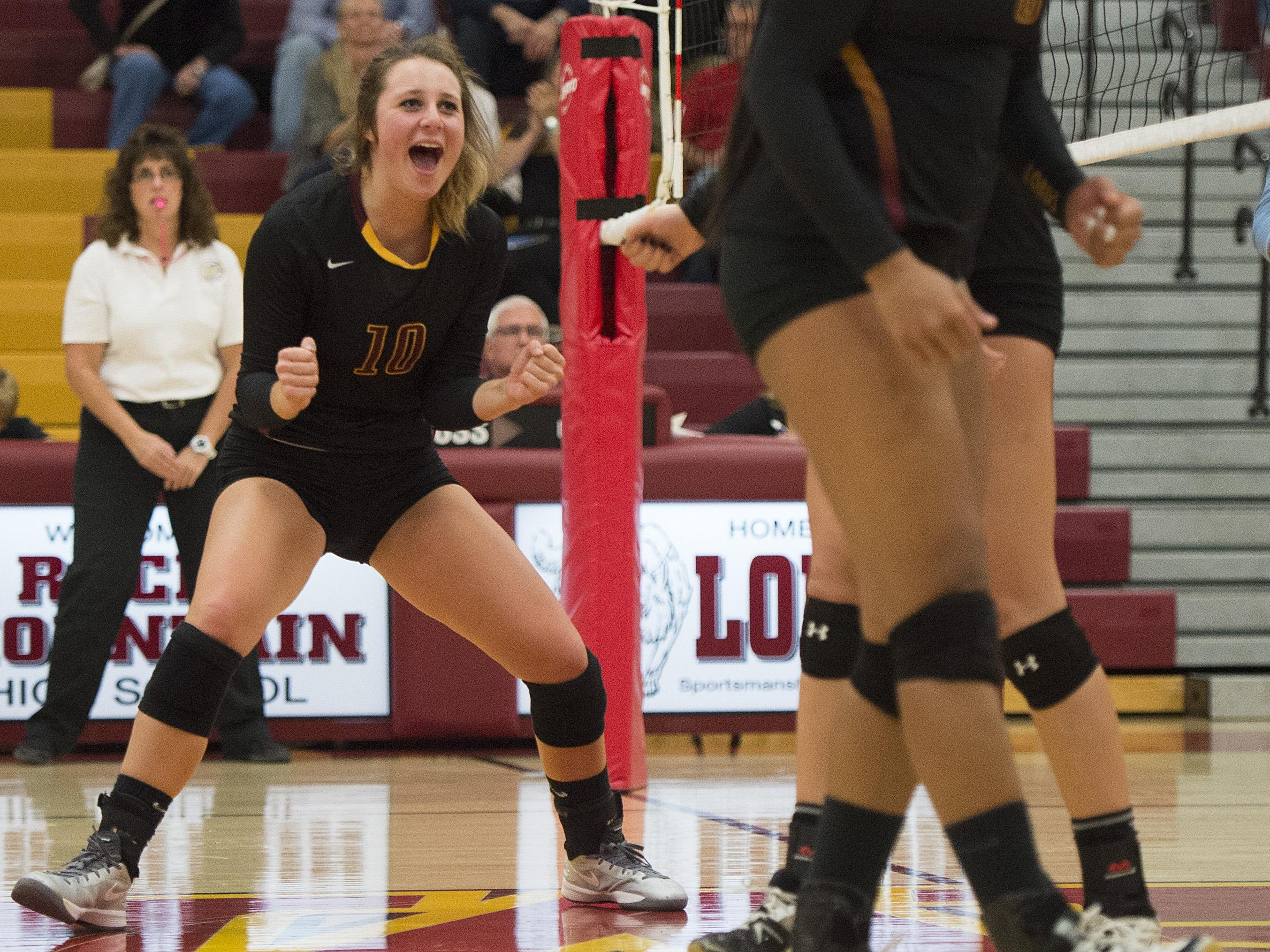 Macie Linne of Rocky Mountain High School celebrates in a match earlier this season. The Lobos play at Fairview in a conference-title match on Tuesday.