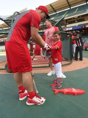 Los Angeles outfielder Mike Trout interacts with Thomas Walkup of Millville Friday before the Angels hosted Toronto.