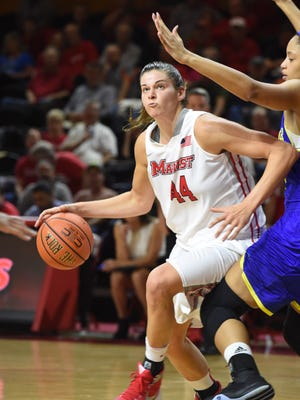 Marist College's Tori Jarosz drives to the basket during a loss to Delaware in McCann Arena on Nov. 19.