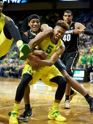 Feb 4, 2016; Eugene, OR, USA; University of Oregon Ducks guard Tyler Dorsey (5) battles for control of a rebound against University of Colorado Buffaloes guard George King (24) at Matthew Knight Arena. Mandatory Credit: Troy Wayrynen-USA TODAY Sports