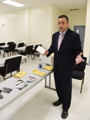 Det. Matthew Daddona of the Town of Poughkeepsie Police Dept. explains a few pieces of evidence from the Ronald Green homicide.