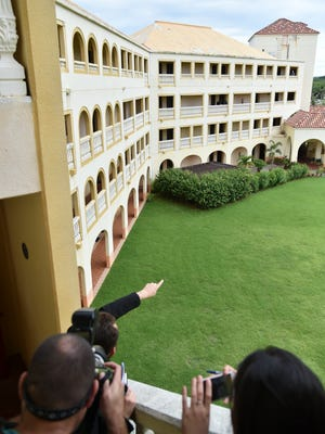 The Rev. Julio Cesar Sancez Malagon, pointing, gives a tour of the Redemptoris Mater Seminary in Yona on Oct. 13, 2016.