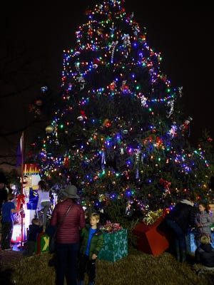 Families enjoy the Christmas tree lighting ceremony Monday, Dec. 5, 2016, at the Brentwood Library.
