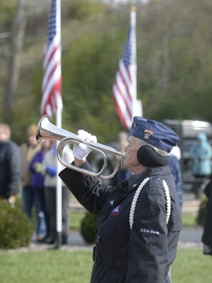 "Bugler Steve Coates plays ""Taps"" during the 2017 Veterans Day Service at Wayne County Veterans Memorial Park in Richmond."