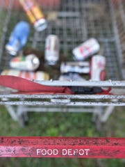 Jackson's Patricia Aaron, who receives food stamps, uses the cart above to collect cans around town to make sure she has enough money for food.