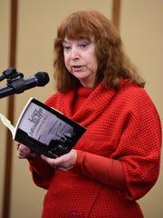 Karen Sleboda of Redford reads her poem, 'Waiting for