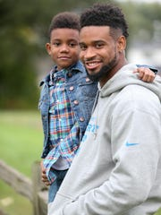 Detroit Lions defensive back Darius Slay with his son Darion Slay 8, who he is raising here in Michigan Tuesday, September 29,2015.