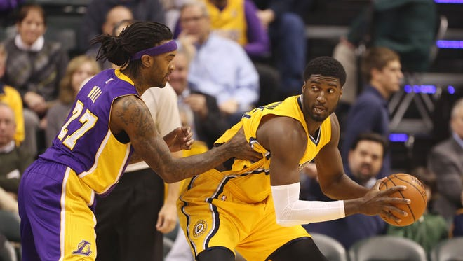 Indiana Pacers center Roy Hibbert (55) posts up against Los Angeles Lakers center Jordan Hill (27) at Bankers Life Fieldhouse.
