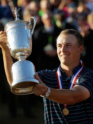 Jordan Spieth holds up the trophy after winning the U.S. Open golf tournament at Chambers Bay on Sunday in University Place, Washington.