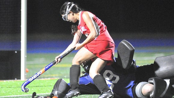 Horace Greeley goalie Willa Kuhn dives to stop Caitlin
