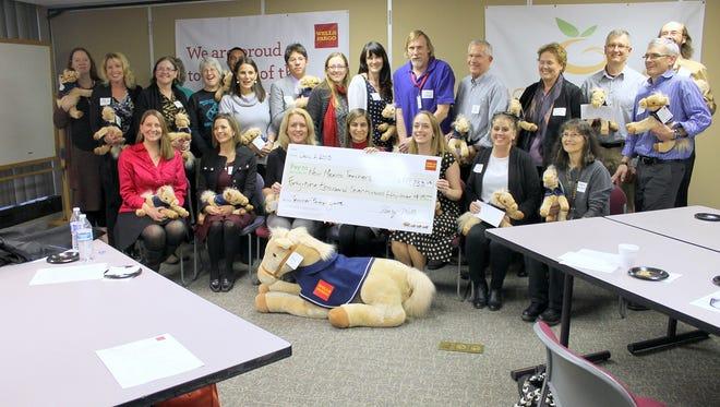 The grant winners of the Wells Fargo/Golden Apple Teacher Partner Program are pictured.
