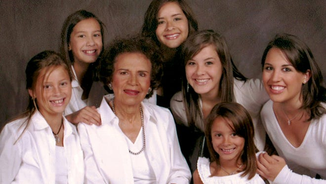 Emma Jean Cervantes with her six granddaughters.