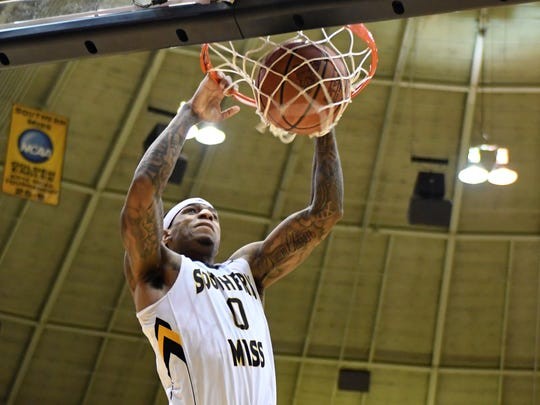Southern Miss' Dominic Magee dunks the ball in a game against Rice in Reed Green Coliseum on Jan. 18, 2018.