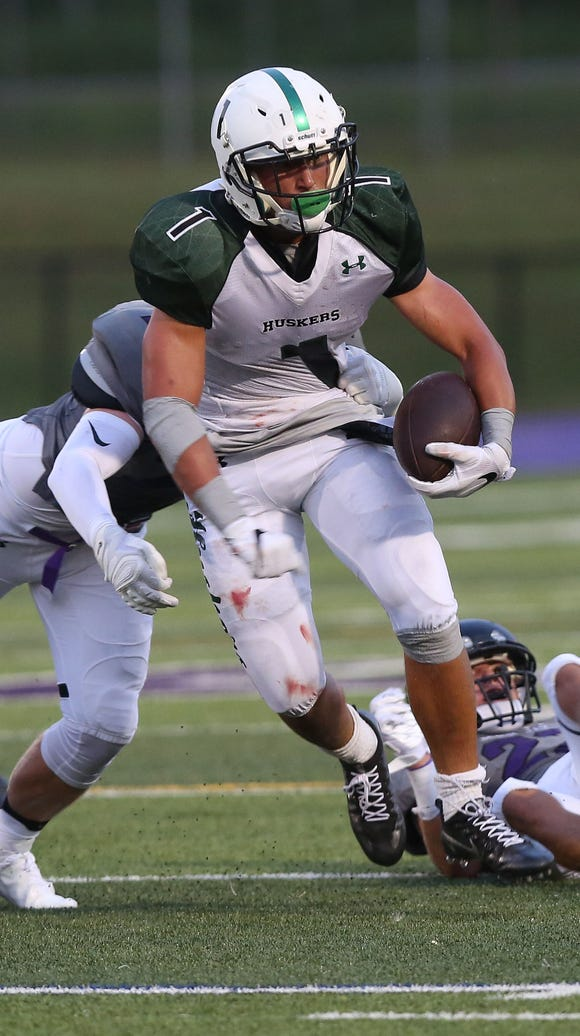 Yorktown's Brett Makar (1) finds some running room